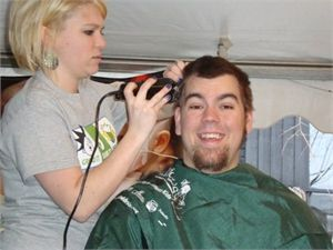 Logan Messer getting hair shaved